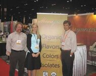 left to right: Tony Moore (Mooreganics), Paige Crist (Perfumer & Flavorist magazine), Tony Willard (A.M. Todd) in front of Mooreganics booth