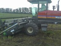 The swather that cuts the peppermint plants
