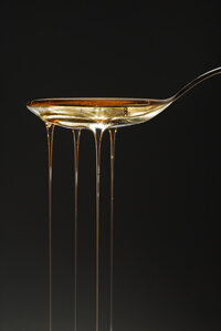 Spoon overflowing with sweet syrup