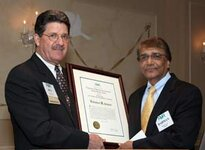William Troy (left, Firmenich) presenting Rahman Ansari (right, Givaudan) the Special Lifetime Achievement Award