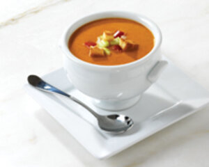 Soup in tureen bowl with spoon