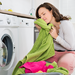 Woman smelling fresh laundry
