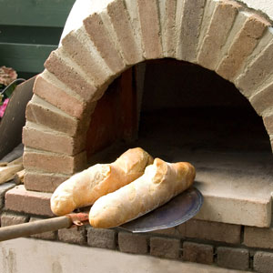 Baking-bread-old-world-oven-300
