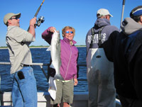 Mary Ann Roberts (IFF) and a striped bass