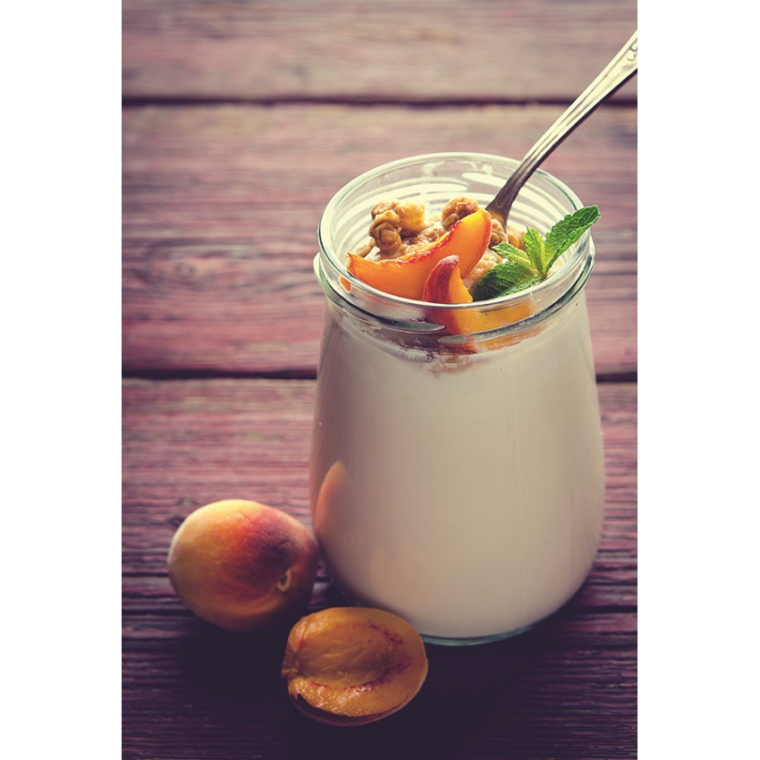 Yogurt with peaches in a glass jar