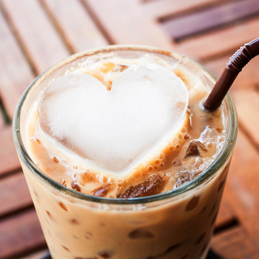 Iced coffee with heart-shaped ice cube