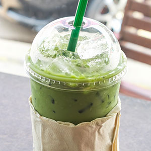 Iced matcha tea outside coffee shop