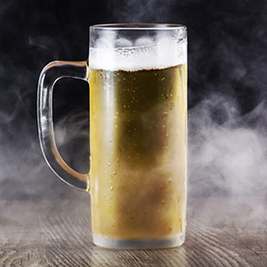 Smoking mug of pale beer