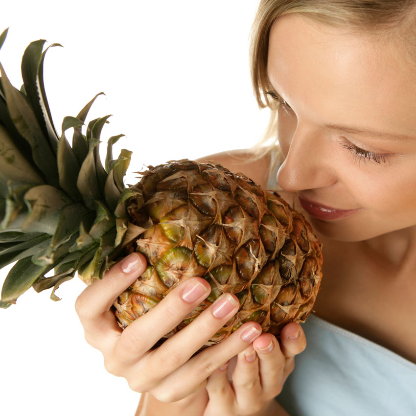 Woman-smelling-pineapple-850