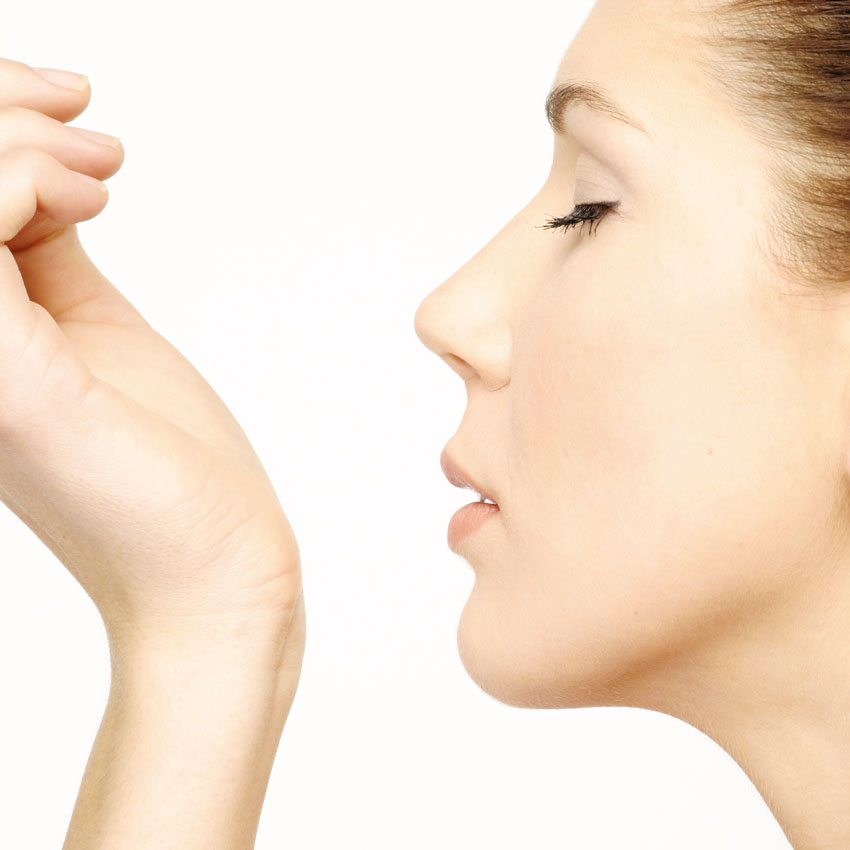 Woman sniffing wrist 850