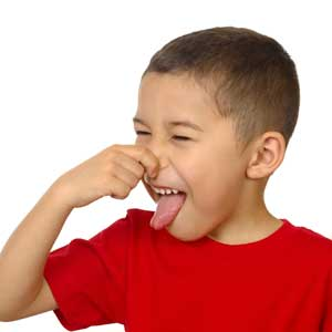 Child plugging nose