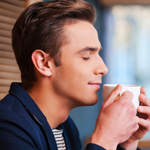 Man smelling coffee