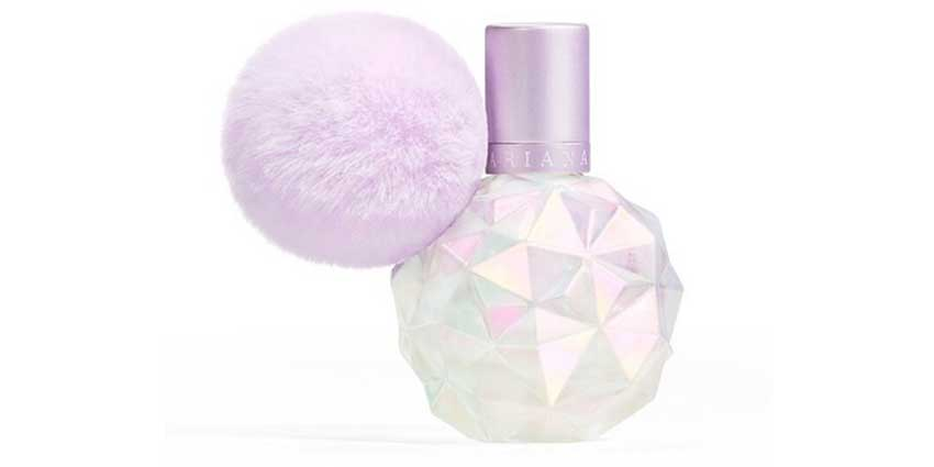 A perfume bottle with pom pom