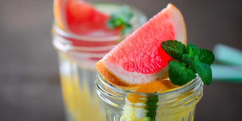 Water with a grapefruit and orange