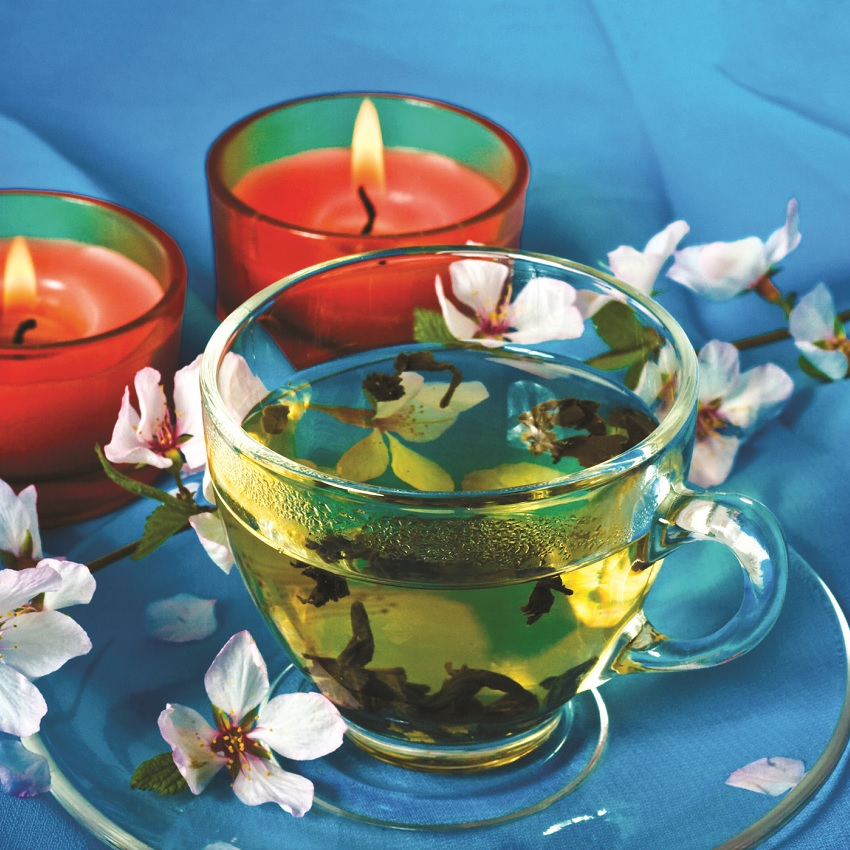 A cup of tea and a candle