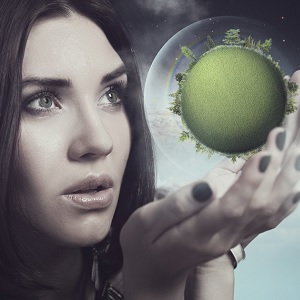 Lady looking at a miniature planet
