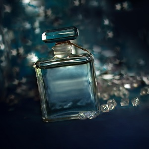 A bottle of perfume with a dark background