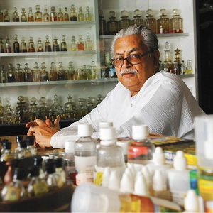 A man with perfume bottles
