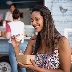 A millennial eating at a food truck