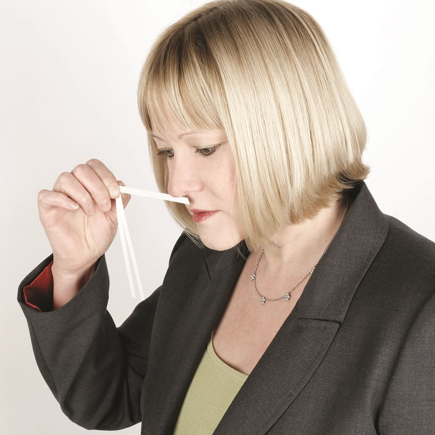 Lisa Hipgrave smelling a scent