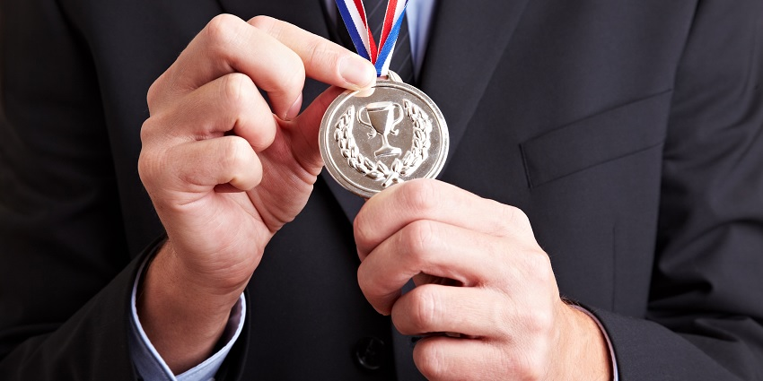 Someone holding a silver medal