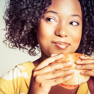 A lady eating a burger