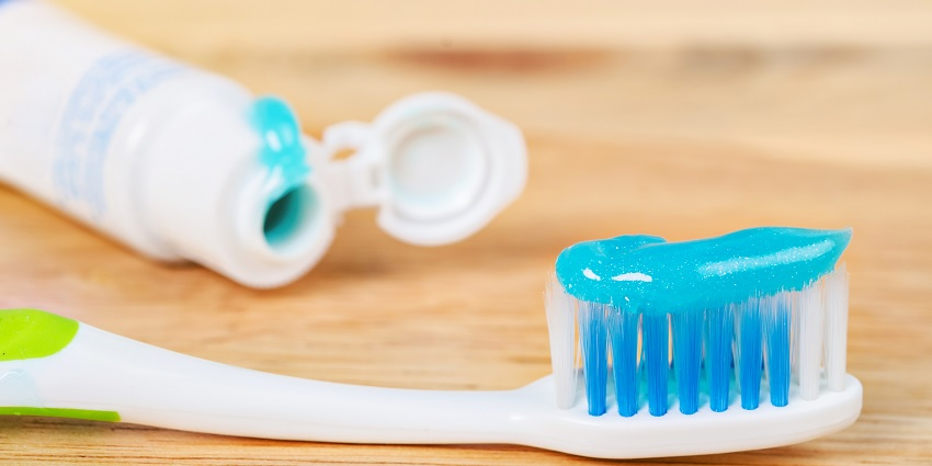 A tooth brush and tooth paste